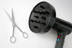 Hair dryer and scissors. Hair dryer with comb and scissors in isolated stock photos