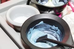 Hair dye in bowls and brush for hair coloring.  royalty free stock photos