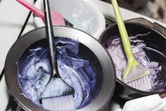 Hair dye in bowls and brush for hair coloring.  royalty free stock image