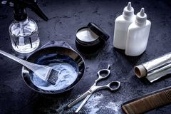 Hair dye with brush on dark background. Close up royalty free stock photos