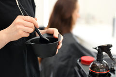 Hair dyeing in hair salon Stock Image