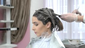 Hair dying, side view. Caucasian woman in beauty salon stock video footage