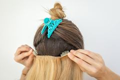 Hair extension clips. Blond Hair extension on clips royalty free stock image