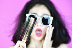 Hair fall problem. Hair fall problem, Woman with hair brush worry about hair loss Stock Image