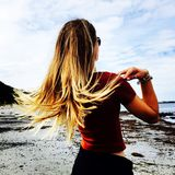 Hair flicking. Girl on beach flicking blonde hair Royalty Free Stock Images