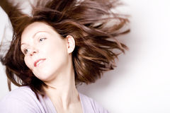 Hair Flow. Young woman throwing her hair all over the place Stock Photo