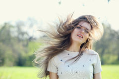 Hair fluttering in the wind Stock Photography