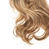 Hair fragment over the white. Wavy hair fragment placed over the white background as a copyspace backdrop composition Stock Images