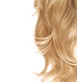 Hair fragment over the white. Wavy hair fragment placed over the white background as a copyspace backdrop composition Royalty Free Stock Images