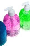 Hair gel bottles over white Royalty Free Stock Photos