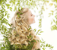 Hair in Green Leaves, Natural Treatment Care, Woman Long Curly. Hair in Green Leaves, Natural Treatment Care, Woman with Long Curly Blond Hairs, Back view over Stock Images