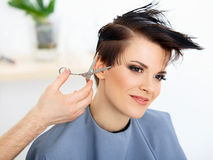 Hair. Hairdresser Cutting Woman's Hair in Beauty Salon.  Haircut Stock Photography