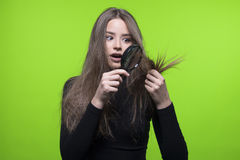 Hair and head skin problem. Beautiful girl with bad and dry hair concept royalty free stock photography