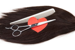 Hair, heart shape and clippers on white background Royalty Free Stock Image