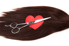 Hair, heart shape and clippers on white background Royalty Free Stock Images