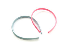 Hair hoops. Two  hair hoops in a form of a heart isolated over white Stock Photography