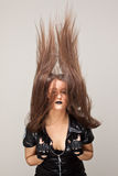 Hair horns. Fashion photo of beautiful woman with magnificent hair looking like horns Stock Photo