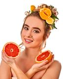 Hair hydrating mask from fresh fruits on woman head. Hair mask from fresh fruits on woman head. Girl with beautiful face holds halves of grapefruit for homemade stock images