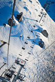 Hair lift in  Winter Landscape. Long ropeway with skiers. Les Arcs Ski Resort, France Stock Images