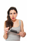 Hair loss. Young female shocked against hair loss Stock Image