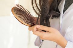 Hair loss problem. Woman hold bruch with Hair loss problem stock photo