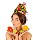 Hair mask from fresh fruits on woman head. Bare shoulders Royalty Free Stock Photography