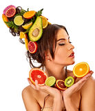 Hair mask from fresh fruits on woman head. Bare shoulders Stock Image