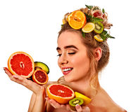 Hair mask from fresh fruits on woman head. Girl with beautiful face. Royalty Free Stock Photo