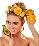 Hair mask from fresh fruits on woman head. Girl with beautiful face. Stock Photography