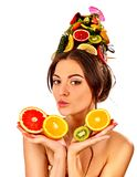 Hair mask from fresh fruits on woman head. Girl with beautiful face. Stock Photo