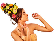 Hair mask from fresh fruits on woman head. Girl with beautiful face. Royalty Free Stock Photos