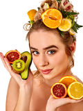 Hair mask from fresh fruits on woman head. Girl with beautiful face. Stock Images