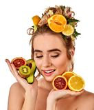 Hair mask from fresh fruits on woman head. Girl with beautiful face. Royalty Free Stock Images