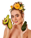 Hair mask from fresh fruits on woman head. Girl hold on hand ingredient kiwi and grapefruit for homemade organic skin and hair therapy. Cosmetics based on royalty free stock photos
