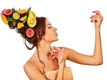 Hair mask from fresh fruits on woman head and spring flowers. Stock Image