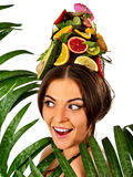 Hair mask from fresh fruits on woman head and spring flowers. Stock Photography