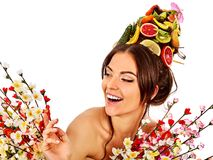 Hair mask from fresh fruits on woman head and spring flowers. Royalty Free Stock Image