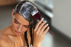 Hair Masks. Woman Applying Mask With Brush On Wet Long Hair. Hair Masking. Young Woman With Brush In Hand Applying Natural Mask On Long Healthy Hair. Beautiful Royalty Free Stock Photo