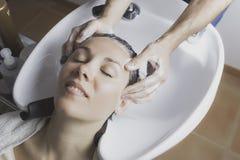 Hair massage at shampoo chairs Stock Photo