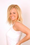 Hair Model. Pretty young blonde woman smile for camera while wearing a white tank top royalty free stock photography