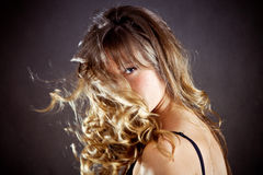 Hair in motion. Beautiful blond woman with hair in motion, studio shot Royalty Free Stock Image
