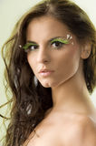 Hair moving. Nice portrait of a cute girl with long hair and green eyelashes royalty free stock photos