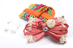 Hair ornaments, earrings and bracelets Stock Photos