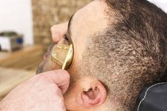 Hair removal. Man`s face sugaring epilation in Turkey. Hair removal. Man`s face sugaring epilations in Turkey royalty free stock photography