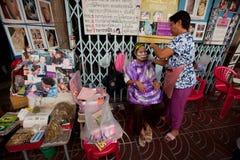 Hair removal (Threading) in Chinatown Bangkok. Royalty Free Stock Photo