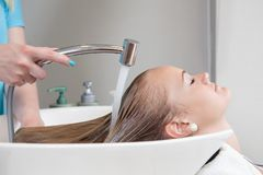 Hair Rinse in Beauty Salon Royalty Free Stock Image