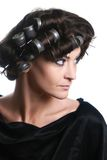 Hair-rollers woman Hair-curlers hairstyle. Hair-rollers. Beautiful woman with hair rollers on the head. Hairdo with hair-curlers Royalty Free Stock Image