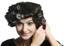 Hair-rollers woman  hairstyle hair-curlers. Hair-rollers. Beautiful woman with hair rollers on the head. Hairdo with hair-rollers Royalty Free Stock Images