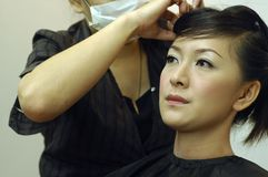 Hair Salon. Beautiful Asian Chinese lady getting her hair done at hair salon Royalty Free Stock Image