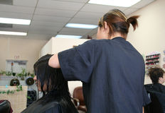 Hair Salon. A photo of a woman getting her hair done at the salon Stock Photography